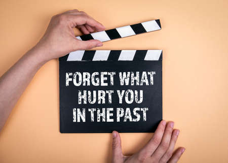 Forget what hurt you in the past. Movie clapper on a light background