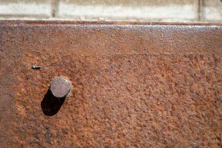 Rust metal background. Iron screw, industrial construction and mechanical engineering