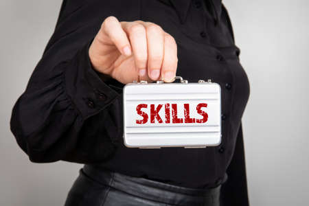 Skills. Business, education and experience concept. woman holding a miniature suitcase Banco de Imagens