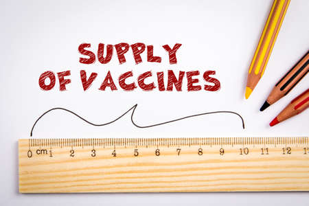 Supply of vaccines. Production, marketing and distribution concept. Wooden ruler and colored pencils