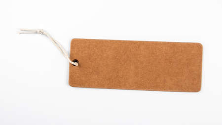 Cardboard price tag with string on a white background