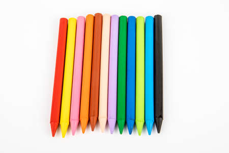 Colored wax crayons on a white background. Education and the creative process concept Stok Fotoğraf