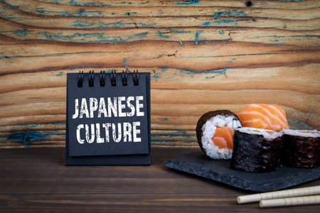 Japanese Culture. Notebook and sushi on wooden texture table Stok Fotoğraf