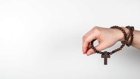 Wooden cross on the woman hand. Horizontal banner with space for text, mock up