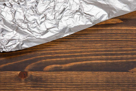 Food foil on a dark wooden table