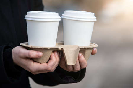 Paper coffee cups to take away. Early morning, breakfast and start of the working day