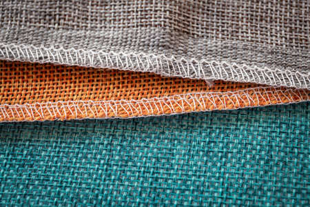 Orange, green and brown textiles. Fabric for decoration, backgrounds and creative works 版權商用圖片
