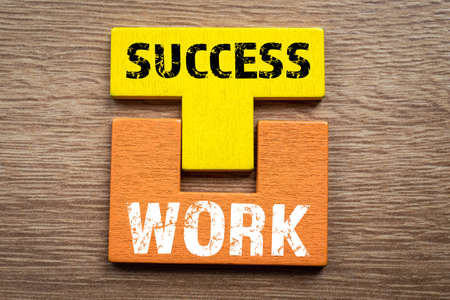 Work and Success concept. Colored wooden blocks