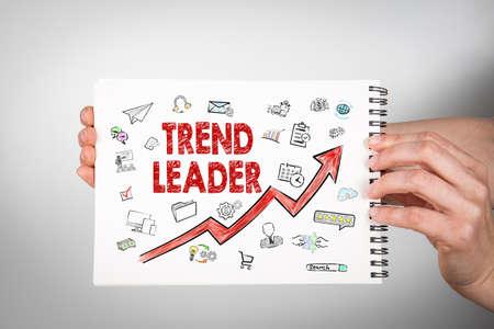 Trend Leader. White notebook in woman hands 版權商用圖片