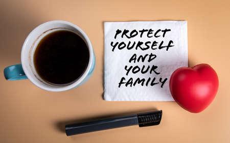 Protect yourself and your family. Coffee mug and napkin on the table