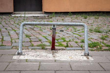 Parking barrier with padlock. Paved area 版權商用圖片