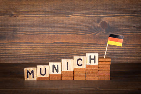 MUNICH city in germany. Wooden alphabet letters and German flag on a wooden background 版權商用圖片