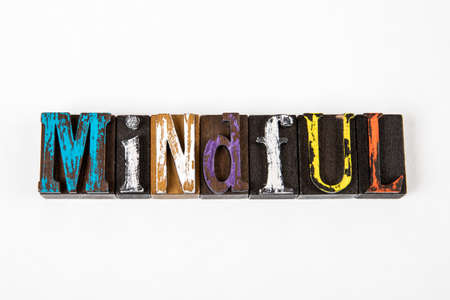 Mindful. Colored wooden alphabet blocks on a white background 版權商用圖片