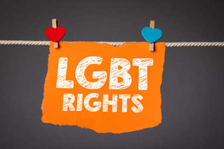 LGBT rights. Orange sheet of paper pinned to the clothesline 版權商用圖片
