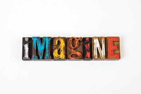 IMAGINE. Colored wooden alphabet letters on a white background