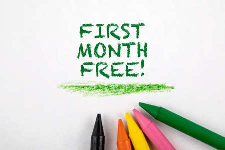 First month free. Colored pastels on a white sheet of paper