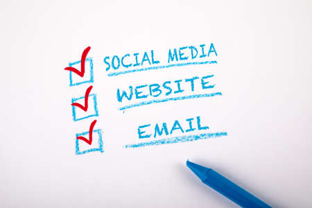 Digital Marketing concept. Social Media, Website and Email. Checklist on a sheet of white paper