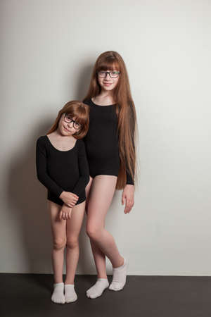 portrait of happy girls in a sports gymnastic swimsuit