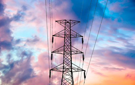 megawatts: High voltage transmission lines on cloud and sky, sunrise period