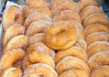 food sales: cooking, asian kitchen, sale and food concept - sugared donuts texture. selective focus Stock Photo