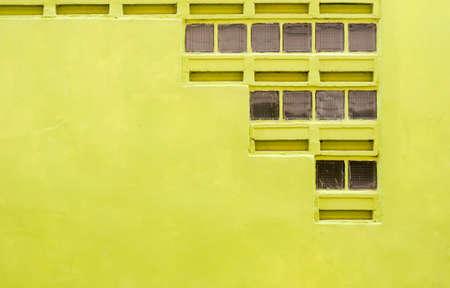 orificio nasal: Muro de hormigón de color amarillo oscuro con espiráculo de textura de fondo