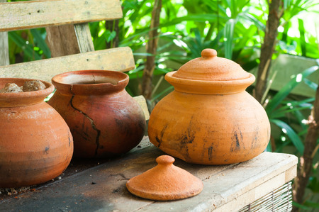 clay pots: Clay pots or porttery on a shelf  outside kitchen room