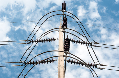 megawatts: High voltage transmission lines on blue sky