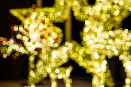 st nick: blurred Bokeh light of star in night time Stock Photo