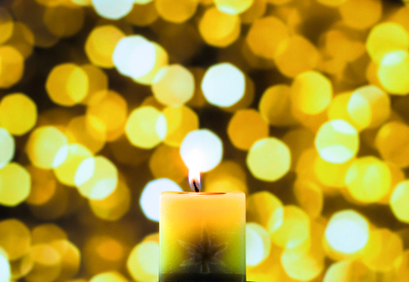 meditative: candle light in yellow bokeh background