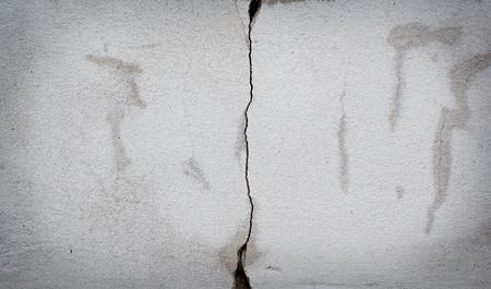 the medium: medium crack of old white concrete wall