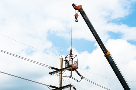 elevator operator: The technician works in a bucket high up on a power pole