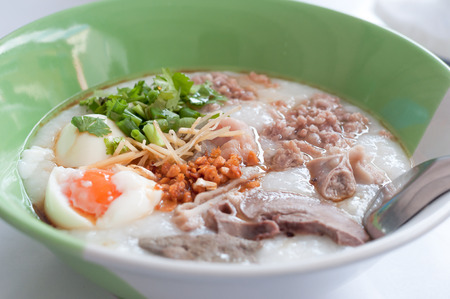 Rice porridge, rice gruel, congee rice soup with egg and pork