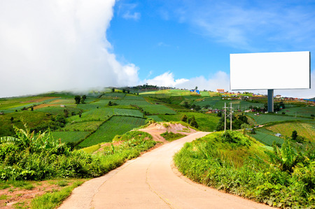 advertise: Beautiful countryside landscape with a Blank billboard for advertisement Stock Photo