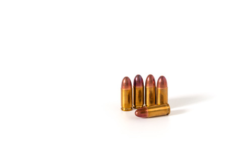9mm ammo: bullet isolated on white background, copy space wuth text Stock Photo