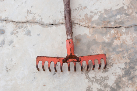 replant: red old rake on the break cement floor ground Stock Photo