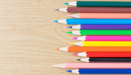 colorful color pencils on the wooden table. copy space