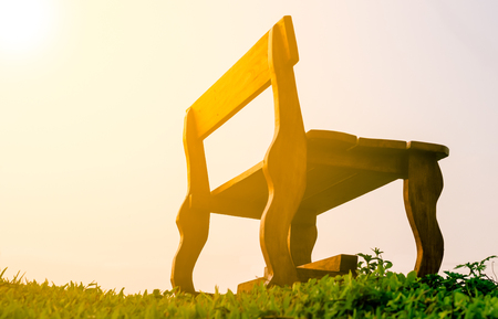 Old Long Chairs Chair on green grass with sunlight in morning period Standard-Bild