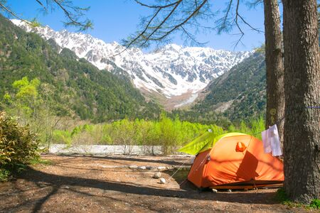 Tent with a view of japan alps mountain, Japan