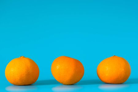 Summer of orange fruit on blue background