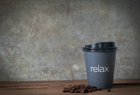 Hot coffee on wooden table with coffee bean Standard-Bild