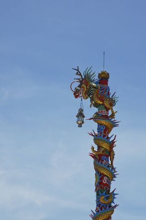 Chinese sculpture on the roof in Thailand photo