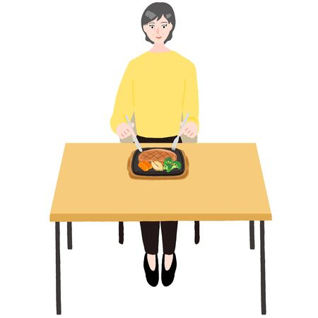 Elderly woman eating steak at a table