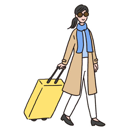 A young woman walking with a suitcase.