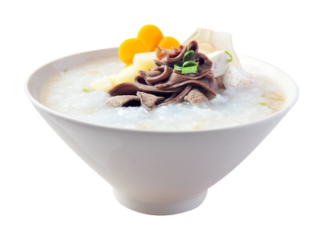 lao: Pork congee with taro, carrot, spring onion - the traditional Chinese Vietnamese breakfast or lunch on isolated white background