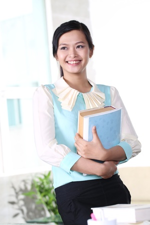 Young girl studying with text book photo