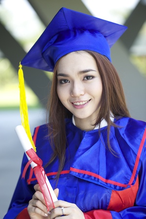 higher education: portrait of a beautiful young asian woman in graduation cap, smile in campus Stock Photo