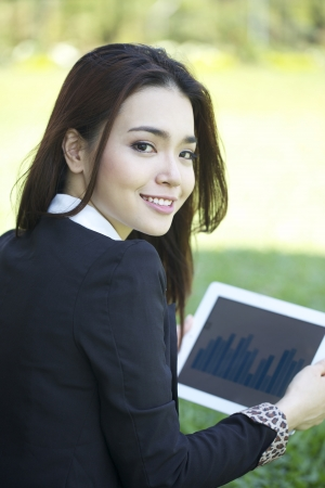 thai student: A portrait of Asian beautiful young woman using tablet outdoor Stock Photo