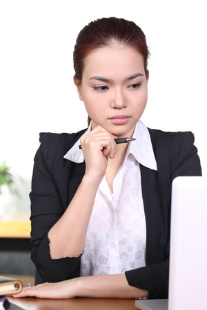 Young business woman working at office, think and look away photo