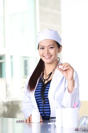 Young doctor woman smile face with stethoscope, model is a asian female photo