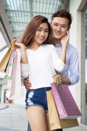 chinese lady: Young Asian happy couple shopping